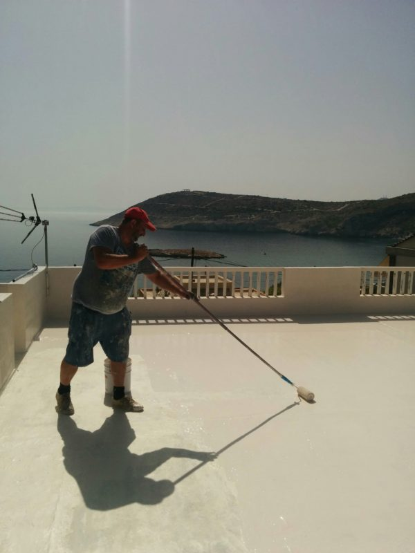 Applying polyurethane waterproofing membrane on concrete rooftop